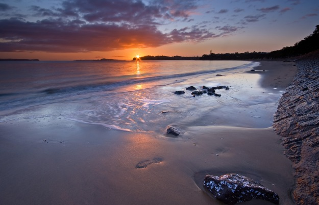Sunrise Over the Ocean Waves and Beach