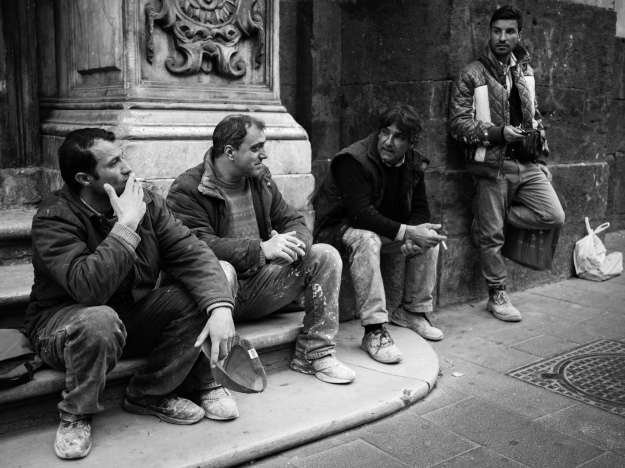 Men Taking a Break from Work to Sit Outside and Smoke